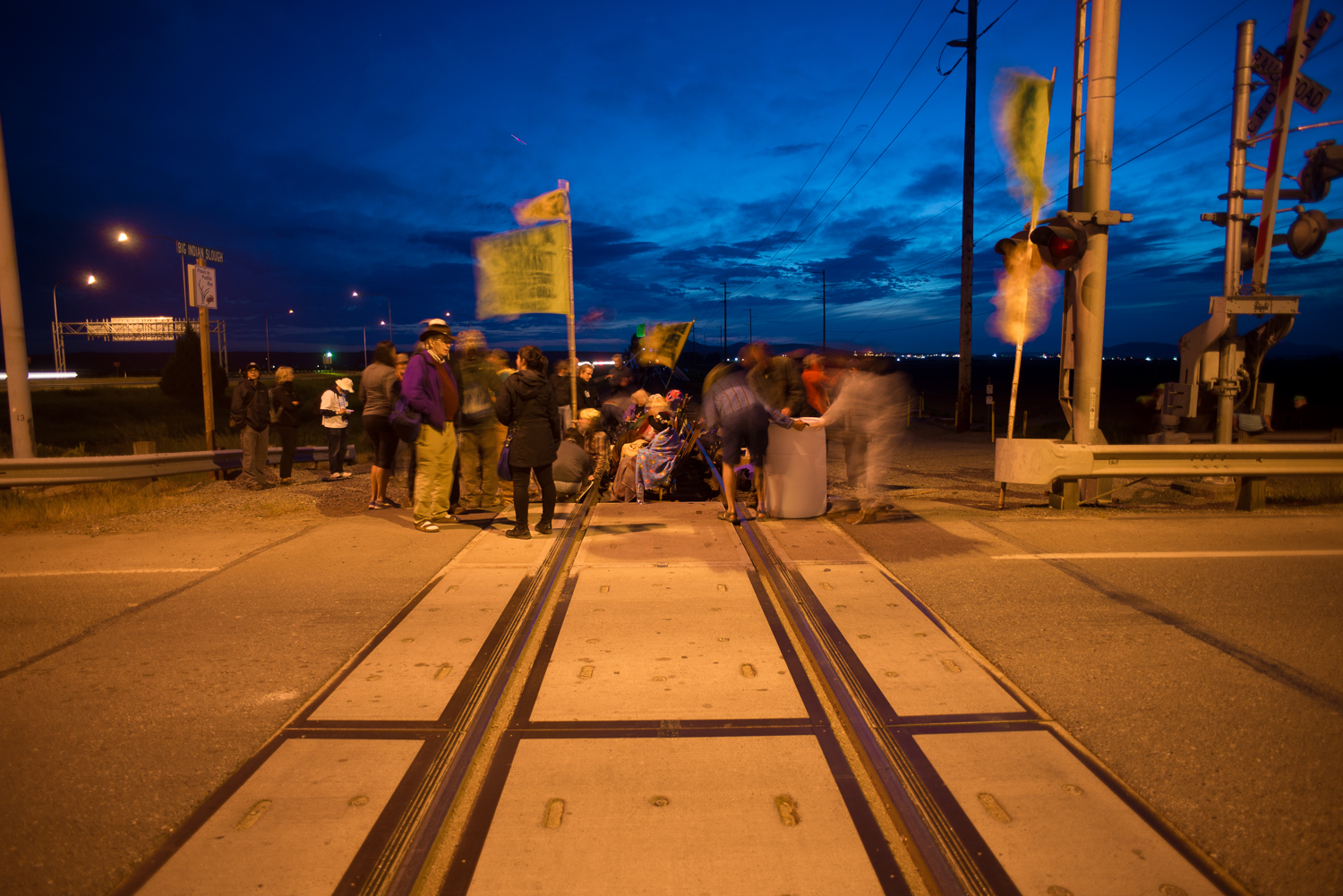 Images shows activists blockading oil trains.